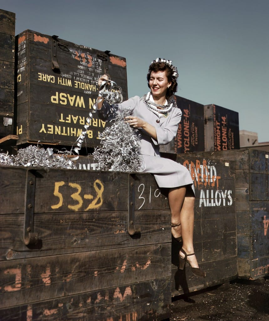 "Long Beach, California. October 1942. ""Annette del Sur publicizing salvage campaign in yard of Douglas Aircraft Company"