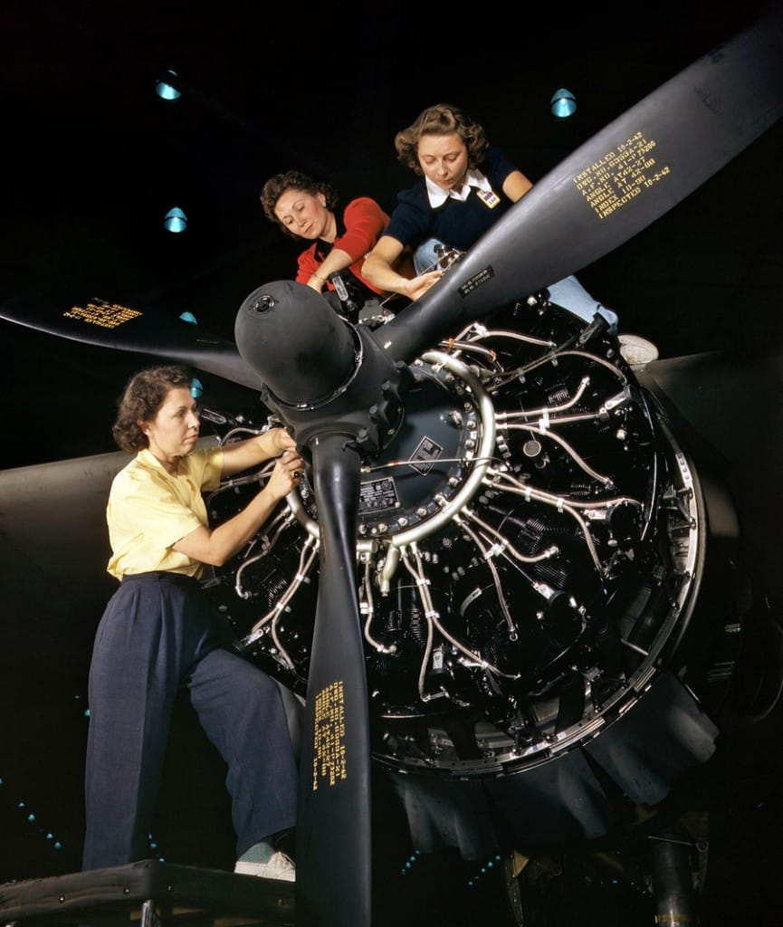 October 1942. Engine installers at Douglas Aircraft in Long Beach, California