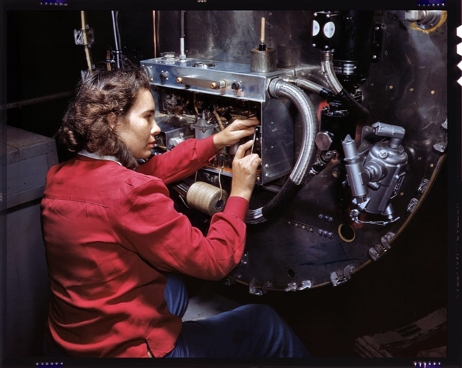 October 1942. Assembling switchboxes on the firewalls of B-25 bomber