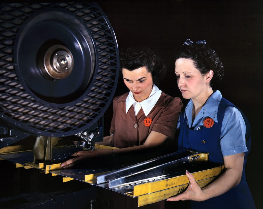 "June 1942. Inglewood, California. ""Punching rivet holes in a frame member for a B-25 bomber at North American Aviation."""