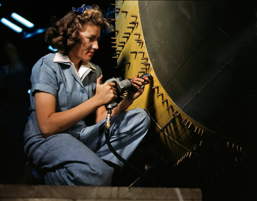 October 1942. Riveter at work on a bomber at the Consolidated Aircraft factory in Fort Worth.