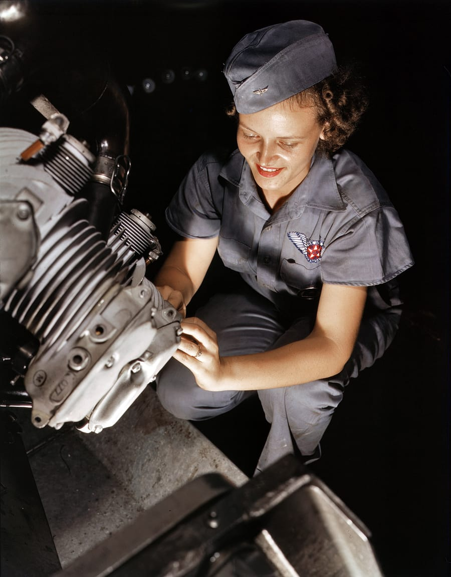 August 1942. Mechanic Mary Josephine Farley works on a Wright Whirlwind motor in the Corpus Christi,