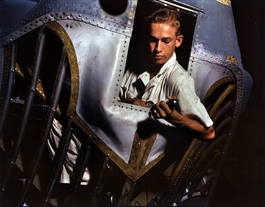 "August 1942. Corpus Christi, Texas. ""Working inside the nose of a PBY,."